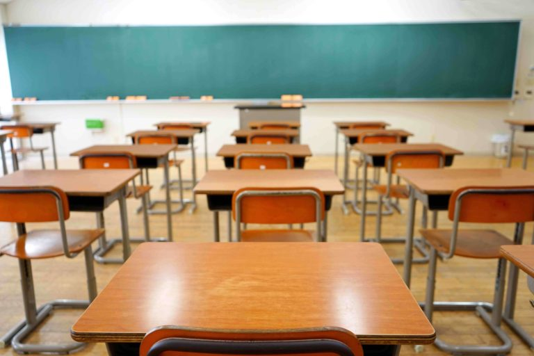 Classroom with desks and chalkboard