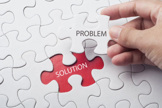 A jigsaw puzzle with the words 'Problem and 'Solution'