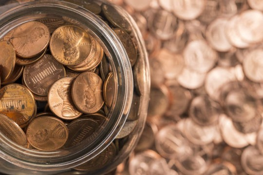 Close up of a jar of pennies